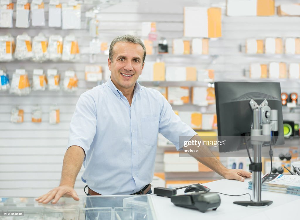 Man running an electronics store : Stock Photo
