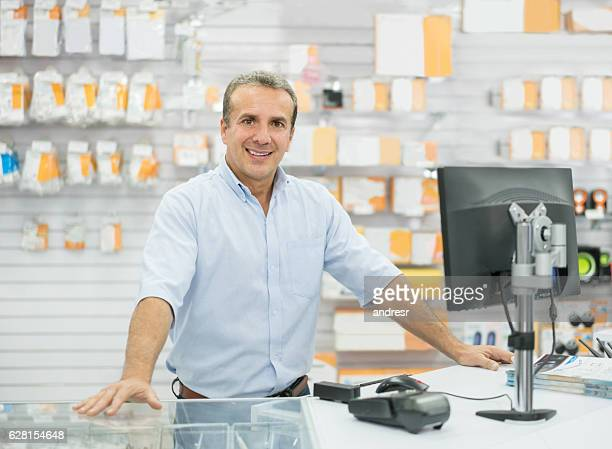 man running an electronics store - electronics store stock photos and pictures