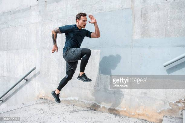 Man running and jumping on the stairs