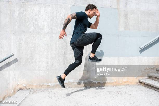 man running and jumping on the stairs - crossfit stock pictures, royalty-free photos & images