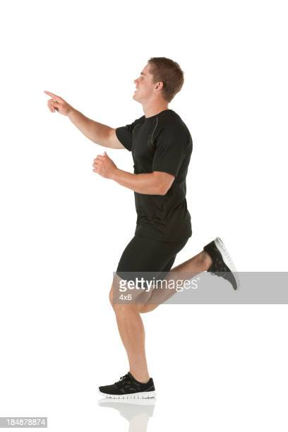 Man running and pointing with finger