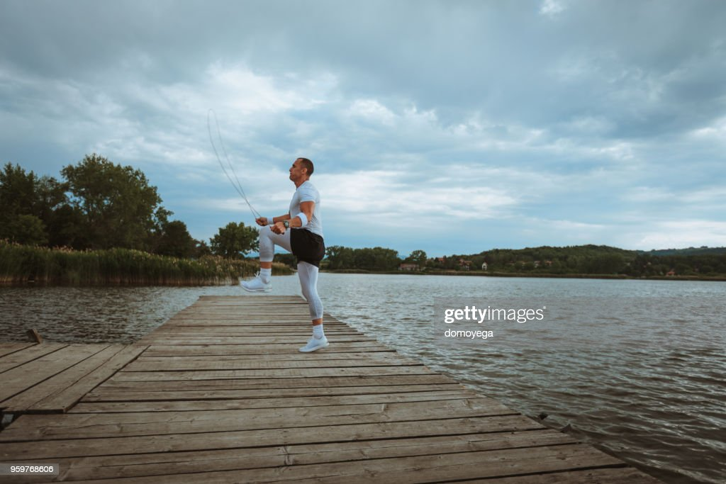 Man running and training outdoors on a summer day : Stock Photo
