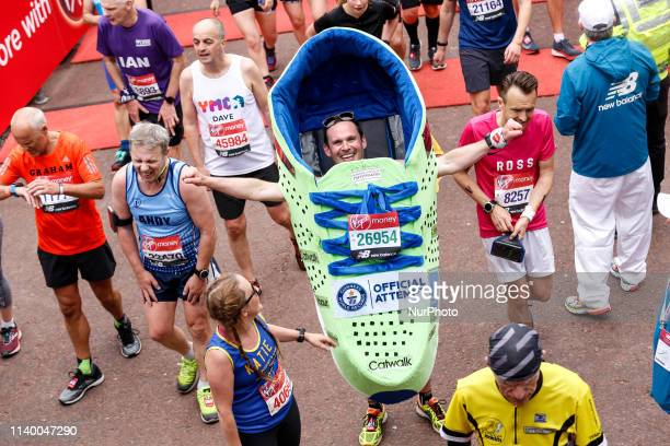 Man running as a shoe crosses the finish line during the Virgin Money London Marathon in London England on April 28 2019 Nearly 43 thousand runners...