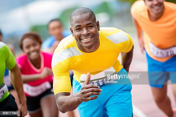 man running at a marathon - sport set competition round stock photos and pictures