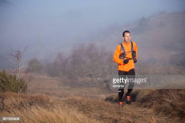 Man running during bad weather