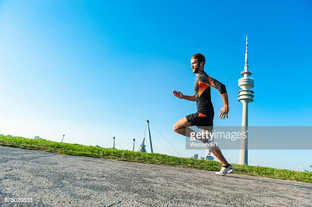 man running fast on path - uphill stock pictures, royalty-free photos & images