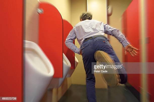 Man running for urinal