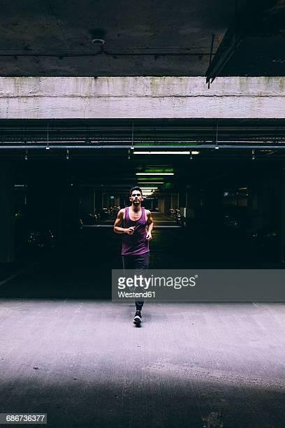 Man running in car park