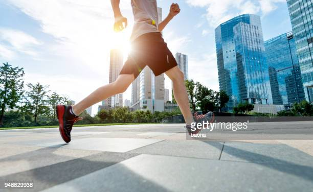 man running in city street - human foot stock pictures, royalty-free photos & images