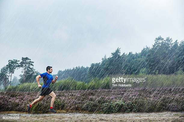 Man running in heavy rain.
