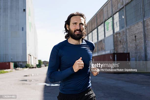 Man running in industrial area