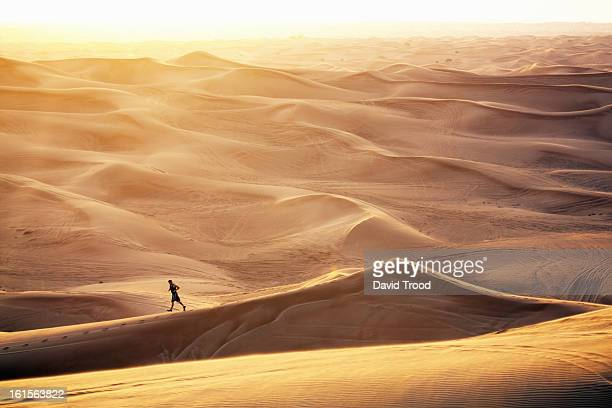 Man running in sand dunes