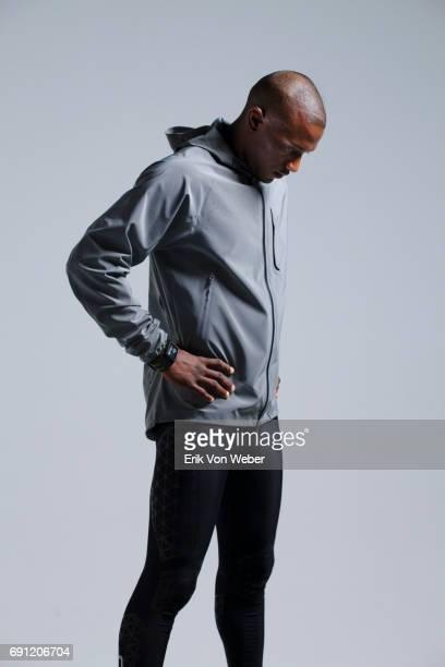 Man running in studio wearing workout apparel