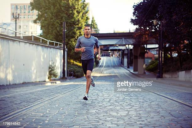 a man running in the city. - jogging stock pictures, royalty-free photos & images