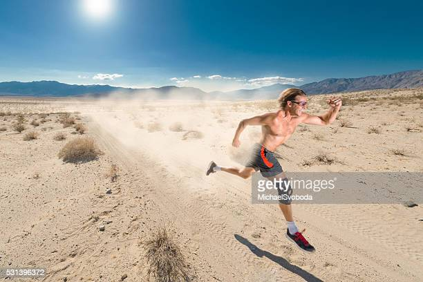 man running in the desert with a trail of dust - anza borrego desert state park stock pictures, royalty-free photos & images