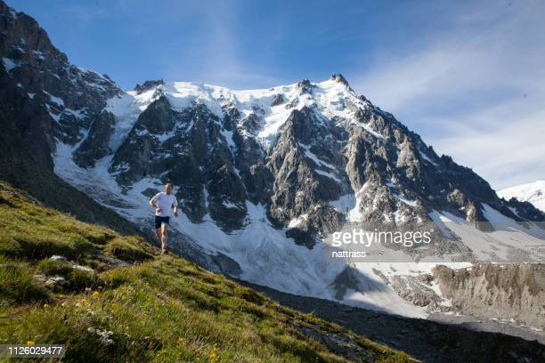 man running in the mountains - auvergne rhône alpes stock pictures, royalty-free photos & images