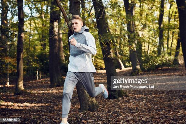 Man running in woods