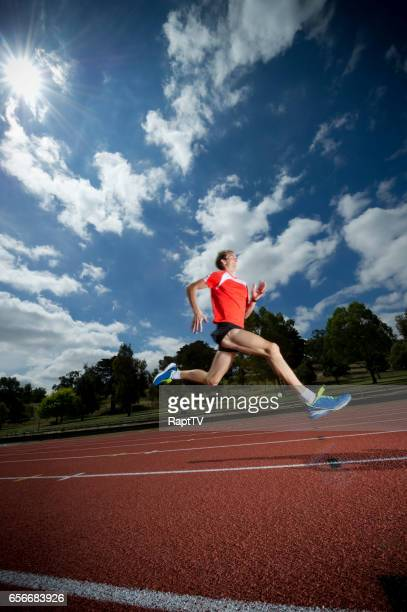 Man running on athletics track.