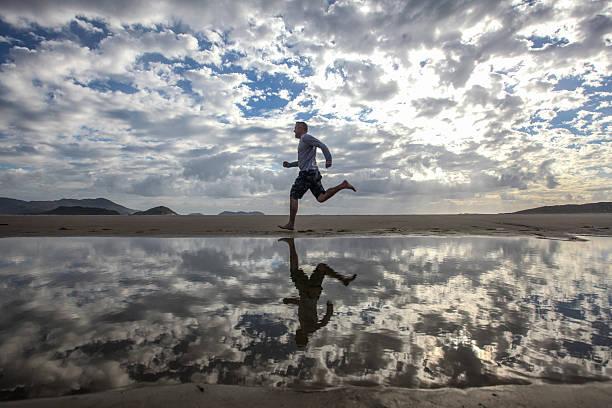 Man Running On Beach Wall Art