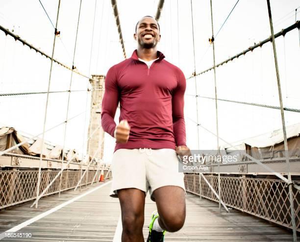 Man running on brooklyn bridge
