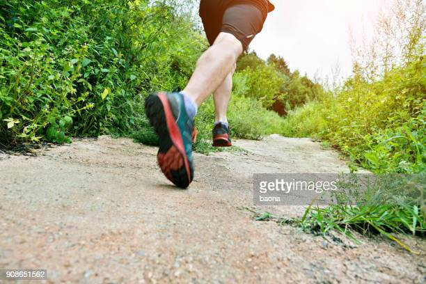 Man running on forest path