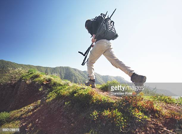 man running on grassy road in mountains - black trousers stock pictures, royalty-free photos & images
