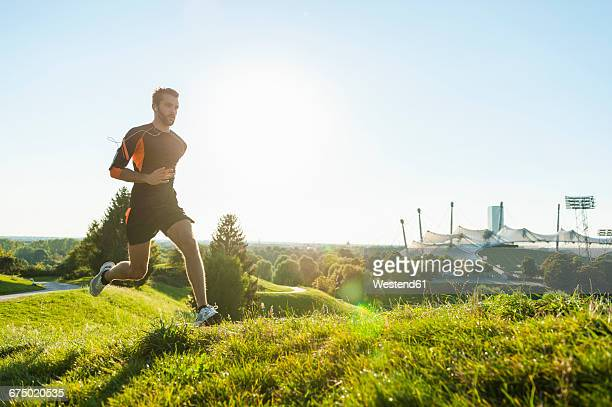 Man running on meadow in park