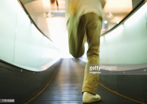 Man running on moving sidewalk