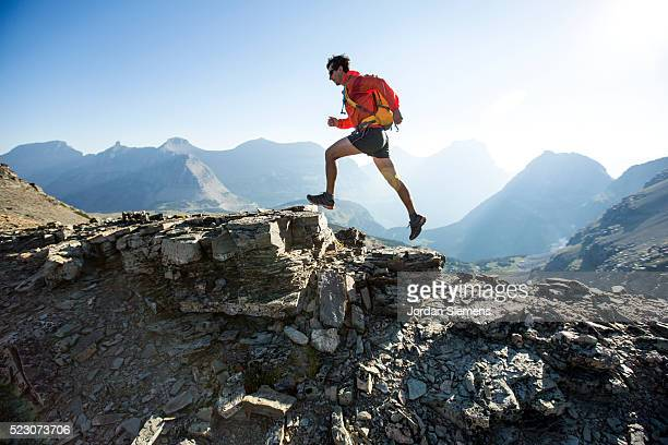 man running on ridge, lewis range, rocky mountains, glacier national park, usa - cross country running stock pictures, royalty-free photos & images