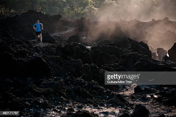 Man running on rocky beach