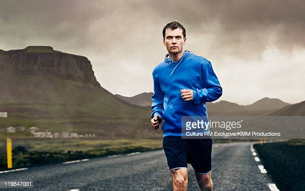 Man running on rural road