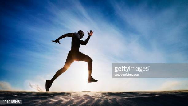 man running on sand dunes. - marathon stock pictures, royalty-free photos & images