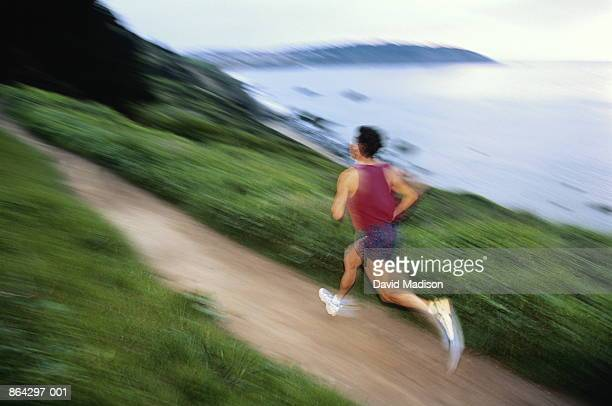 man running on seaside trail, california, usa - david cliff stock pictures, royalty-free photos & images