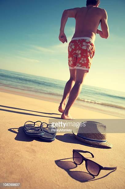 Man Running on Smooth Beach Vintage Effect