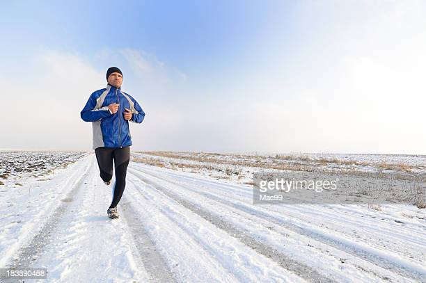 Man running on snowy winter road