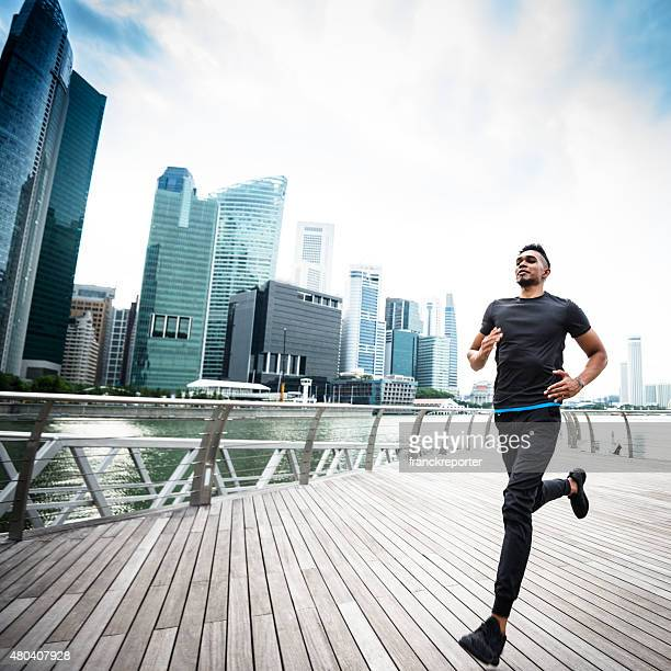man running on the city of singapore marina bay area