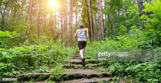 Man running on the steps of forest