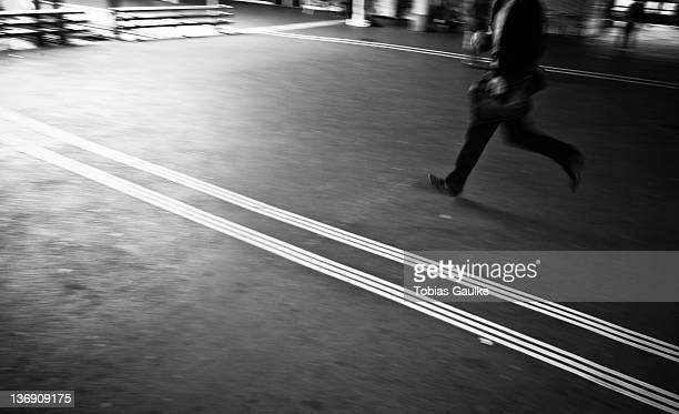 Man running on train station platform