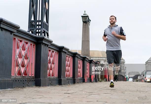 Man running outdoors listening to music