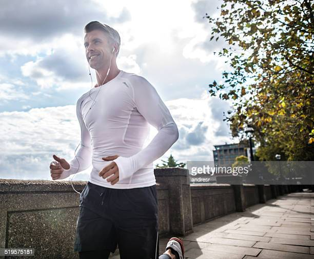 man running outdoors - handsome older men stock pictures, royalty-free photos & images