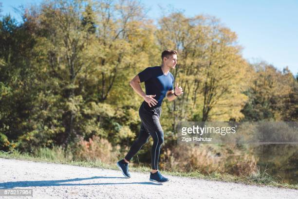 man running outdoors - slow motion stock pictures, royalty-free photos & images