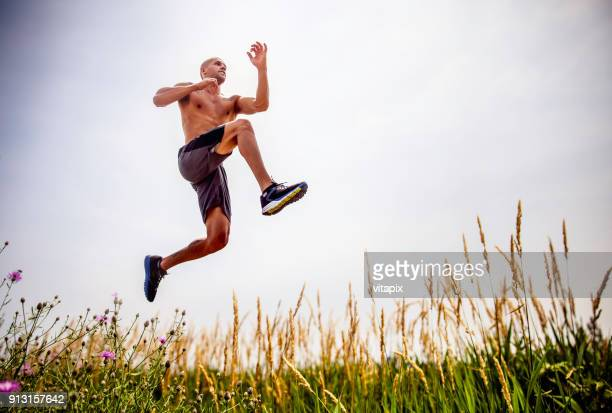 man running outdoors - sportsperson stock pictures, royalty-free photos & images
