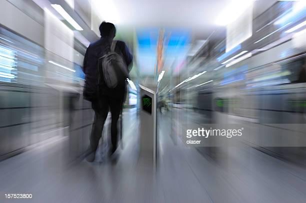 Man running through subway gates