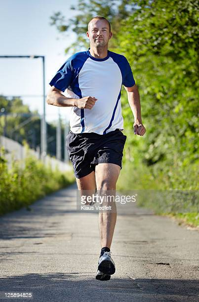 Man running towards camera smiling