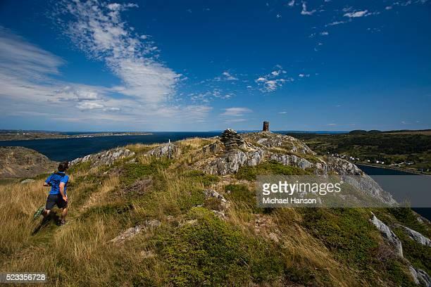 man running towards tower, st. john's, newfoundland and labrador, canada - paisajes de st johns fotografías e imágenes de stock
