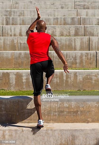 Man running up stairs.