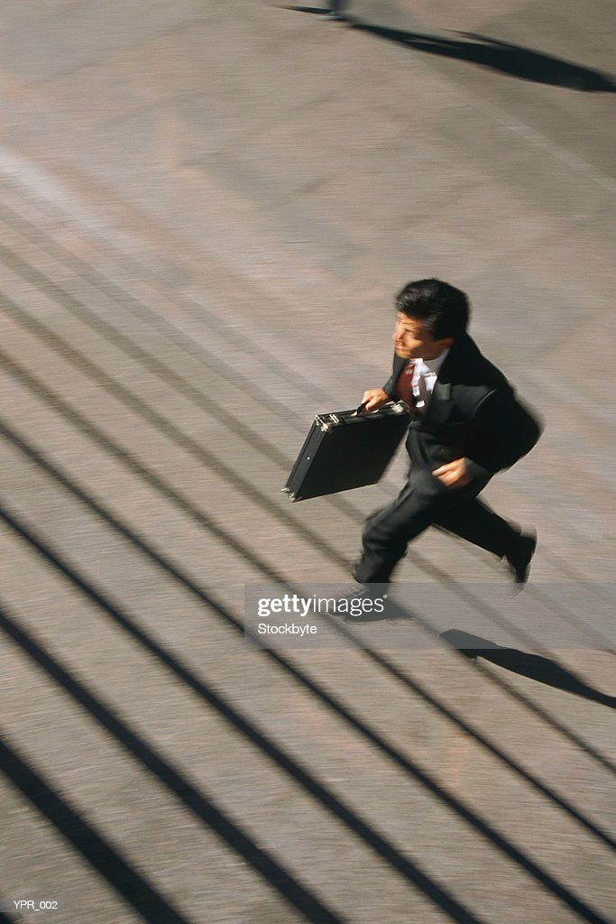 Man running up stairs : Stock Photo