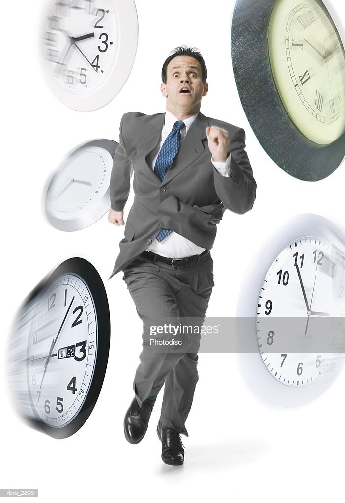 Man running with clocks superimposed beside him : Foto de stock
