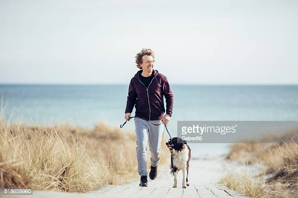 Man running with his dog
