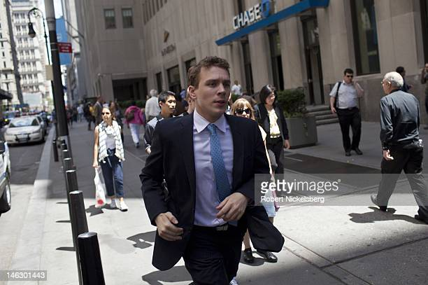 A man runs along Broadway June 7 2012 near Wall Street and the New York Stock Exchange in New York City